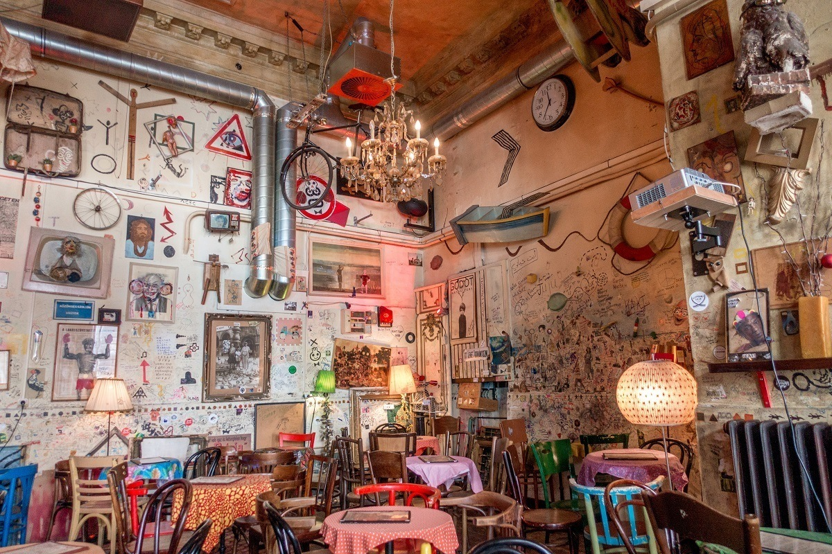 Drawings and photos on the walls at Csendes Vintage Bar