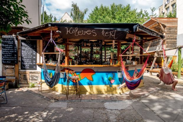 The swings at the bar make a great place to enjoy Koleves kert Budapest, Hungary