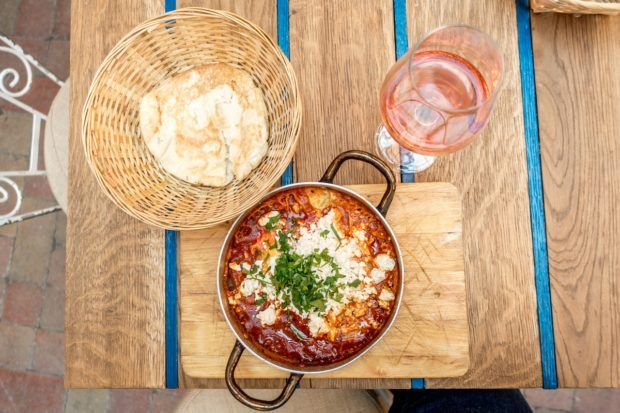 Shakshuka and great Hungarian wine at Mazel Tov, one of the best ruin bars in Budapest Hungary
