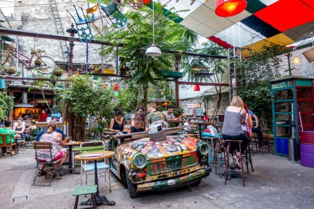 Hang out at the Trabant table at Szimpla bar, one of the most famous Budapest ruin bars