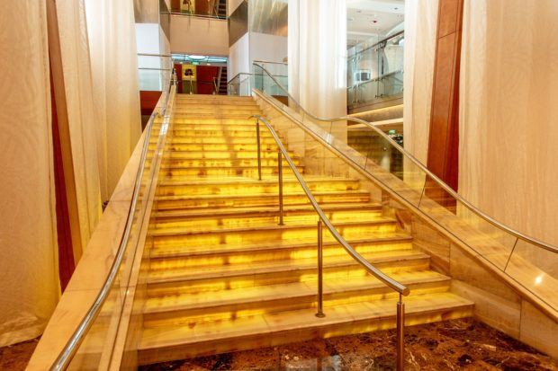 The steps in the main foyer of the Celebrity Summit, an older cruise ship.  If you're wondering what to know about going a cruise, you'll be able to save significant money by booking on an older ship.