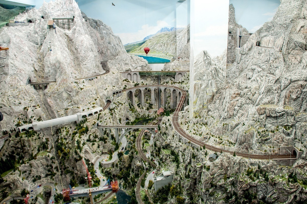 A model train in the mimicking the Swiss Alps