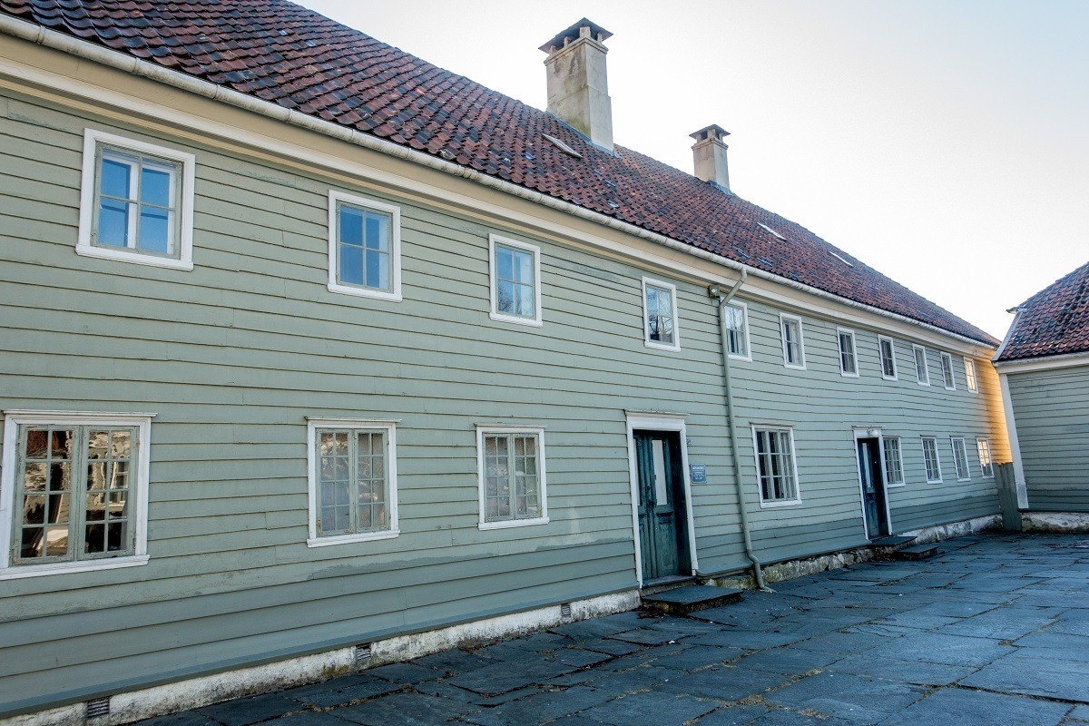 Exterior of building with green paneling, The Leprosy Museum in Bergen