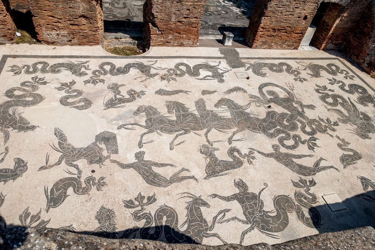 Mosaic with black horses and gods at the Baths of Neptune in Ostia Antica, Italy