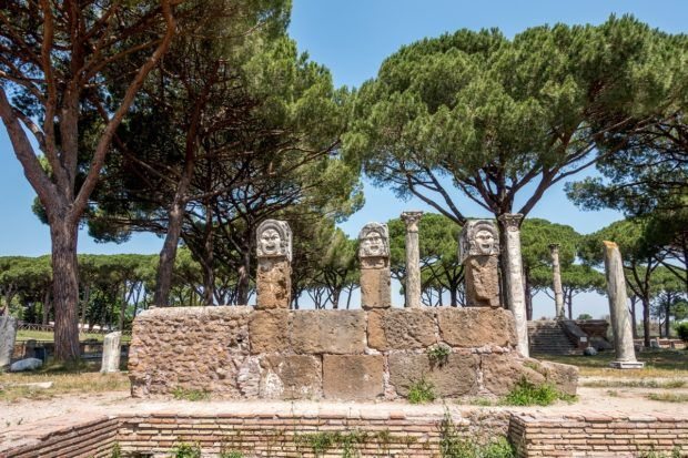 Theatrical masks near the theater at Ostia Antica, Italy
