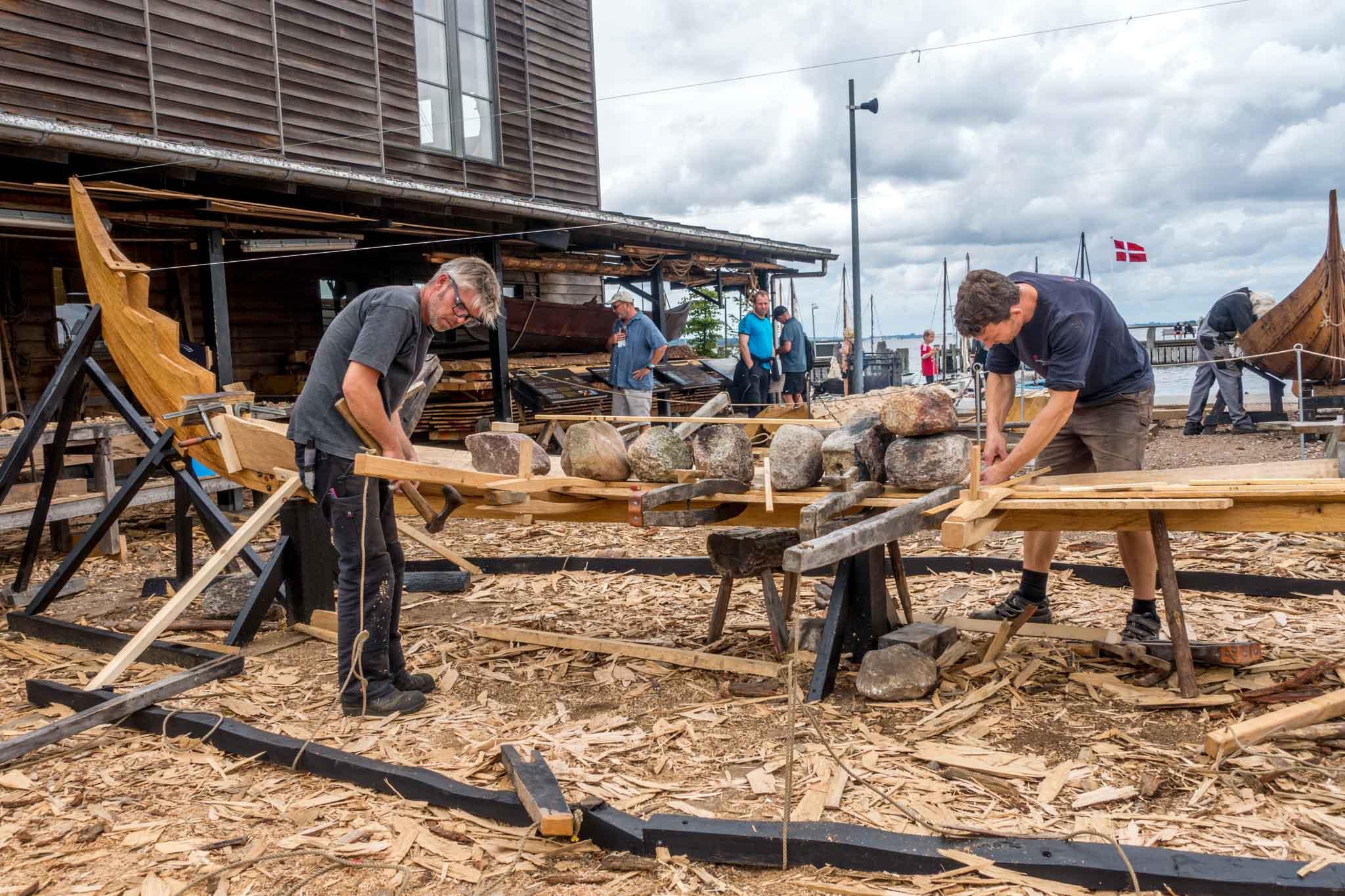 Expert builders building replica viking ships at the Viking Ship Museum in Roskilde Denmark