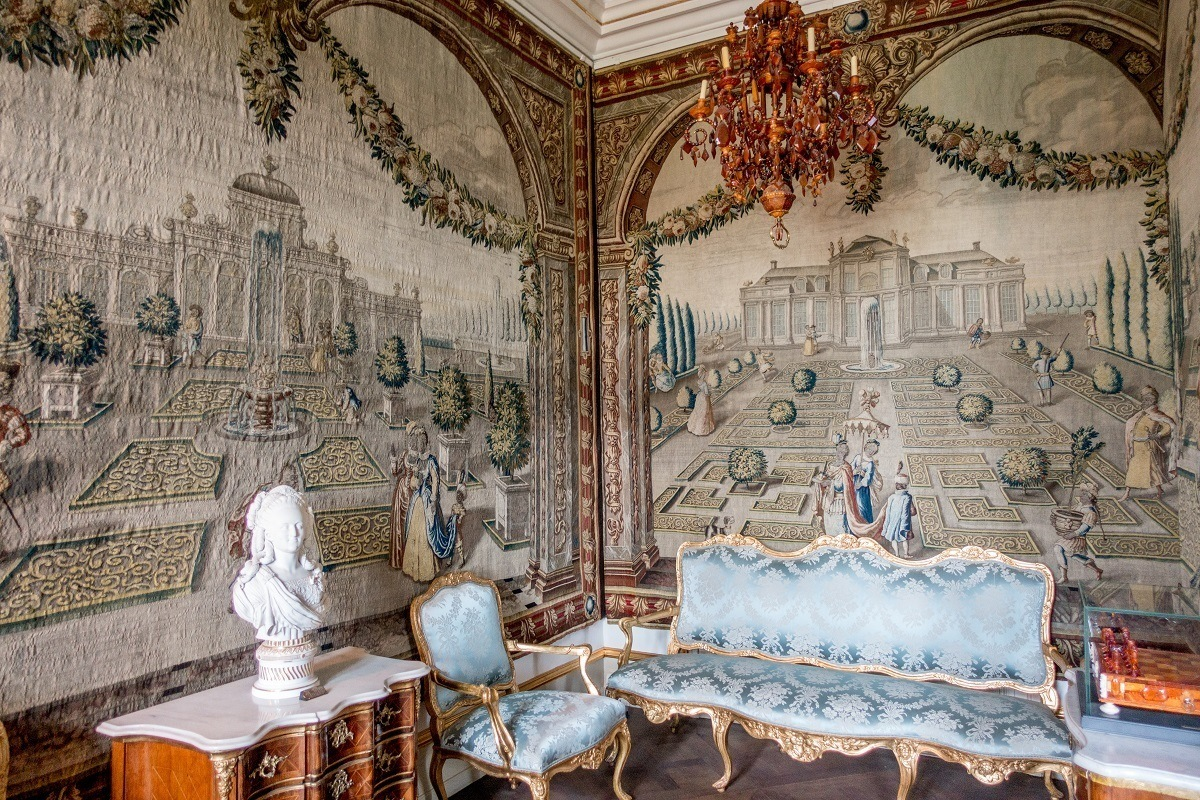 Seeing the tapestries and brocade furniture in Rosenborg Castle is a must do in Copenhagen Denmark