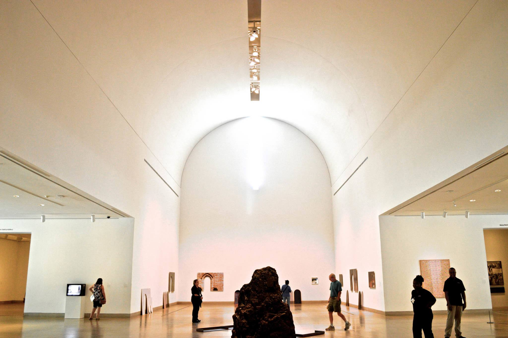 Interior of the Dallas Museum of Art with paintings and visitors