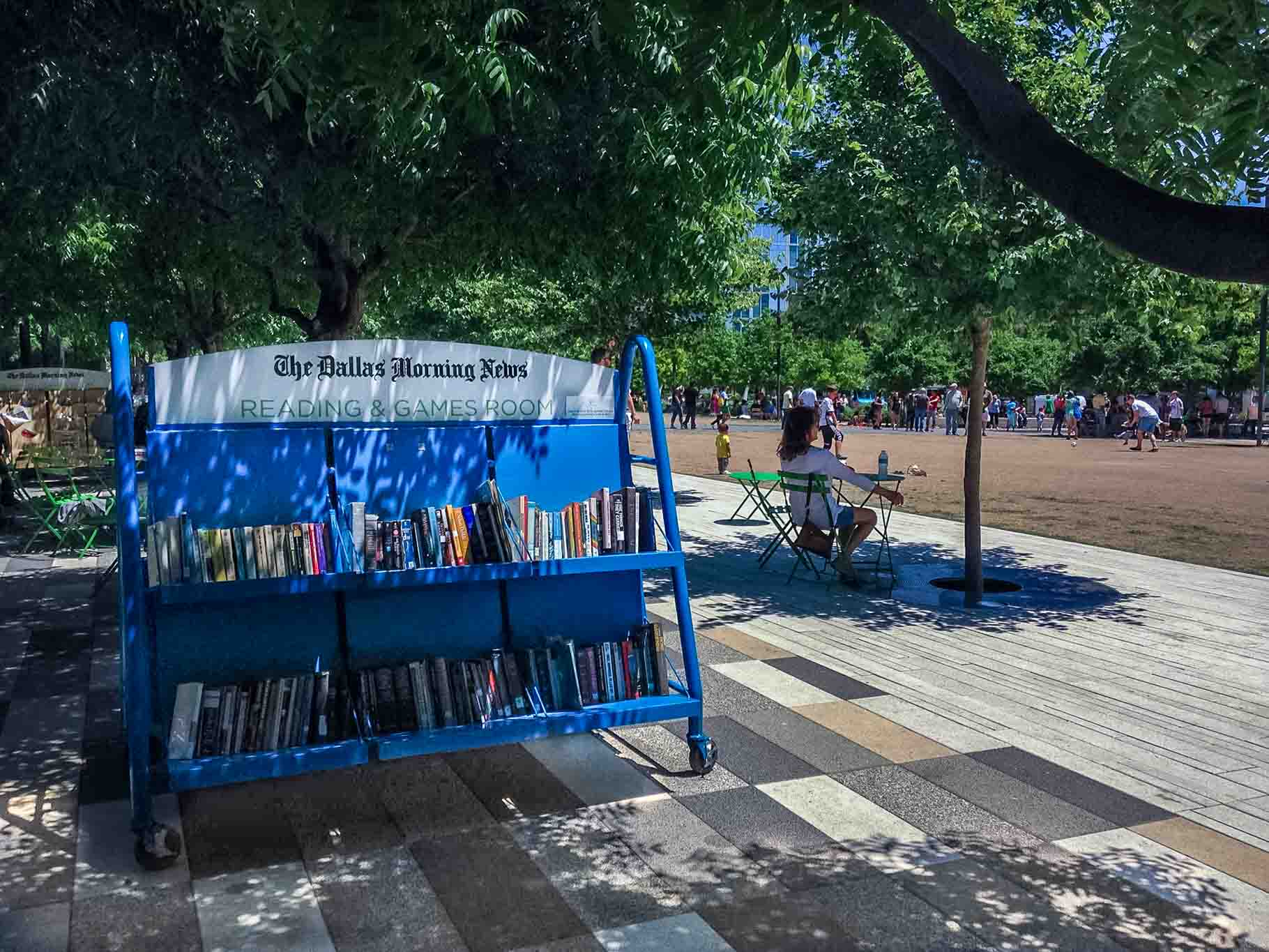 Reading area and books on shelf at Klyde Warren Park