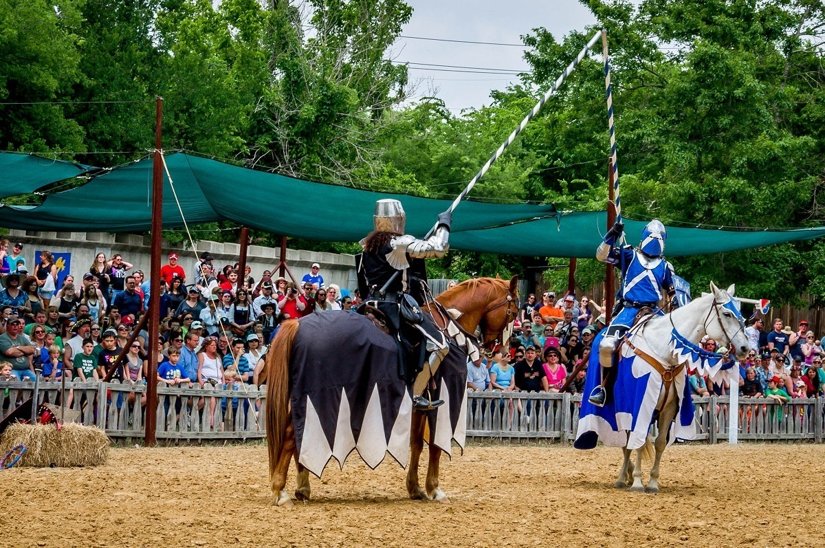 Knights jousting on horseback at Scarborough Renaissance Festival near Dallas, Texas