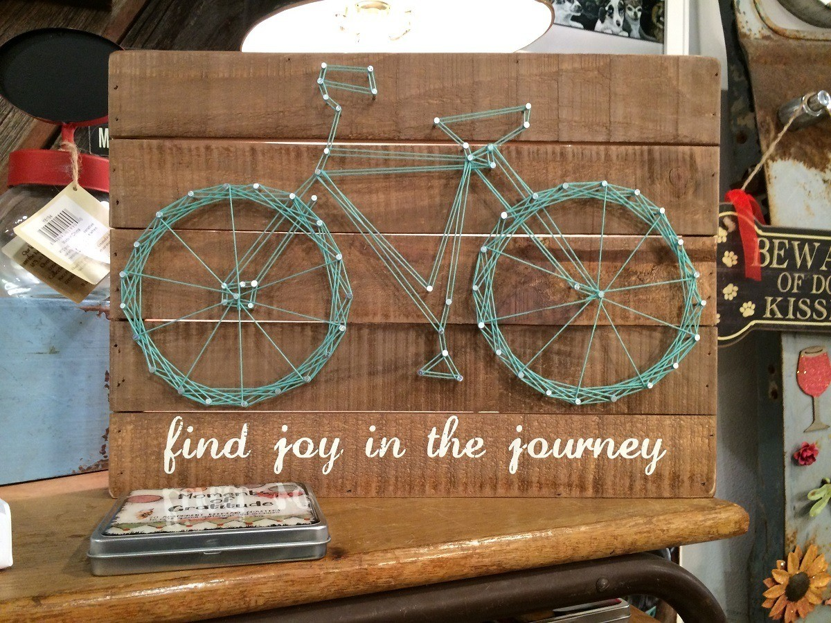 "Decoration featuring bicycle and labeled ""find the joy in the journey"""