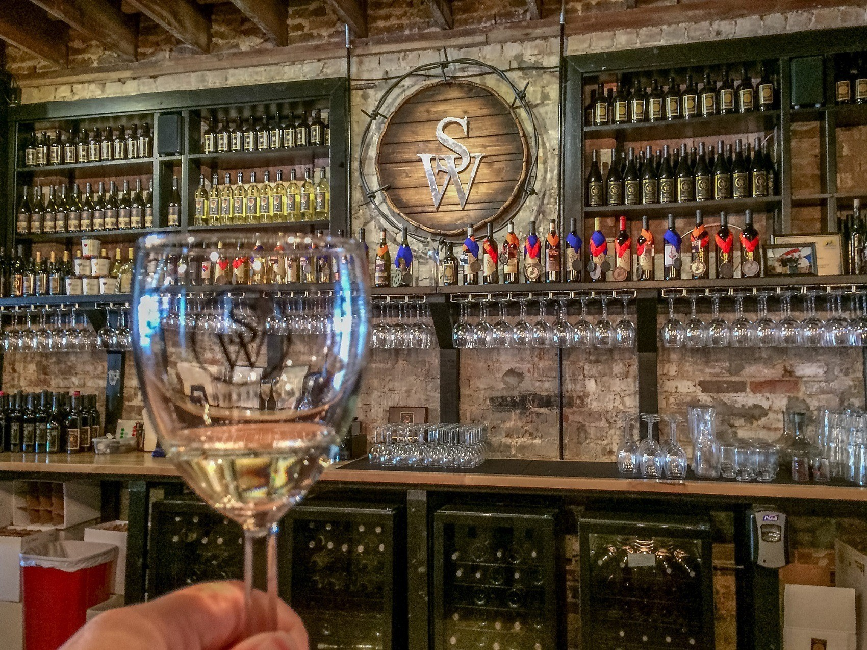 Wine glass and bar at Sloan & Williams Winery