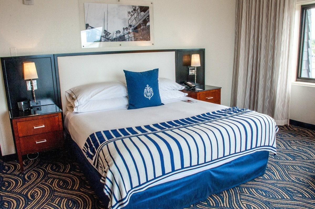 "Bed in the bedroom in the ""nautical chique"" style at the hotel"