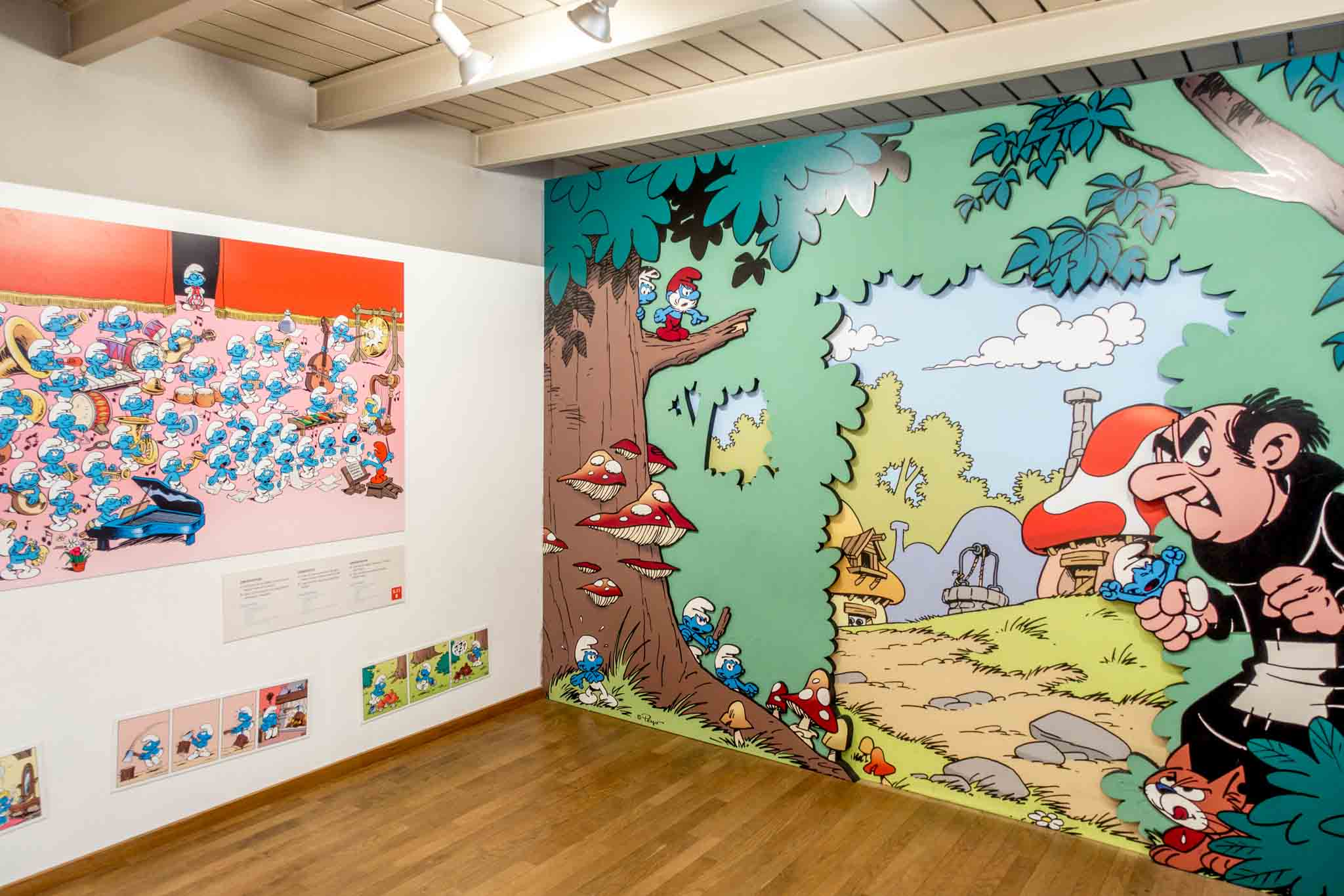 Cartoons drawings from The Smurfs that are displayed in a museum