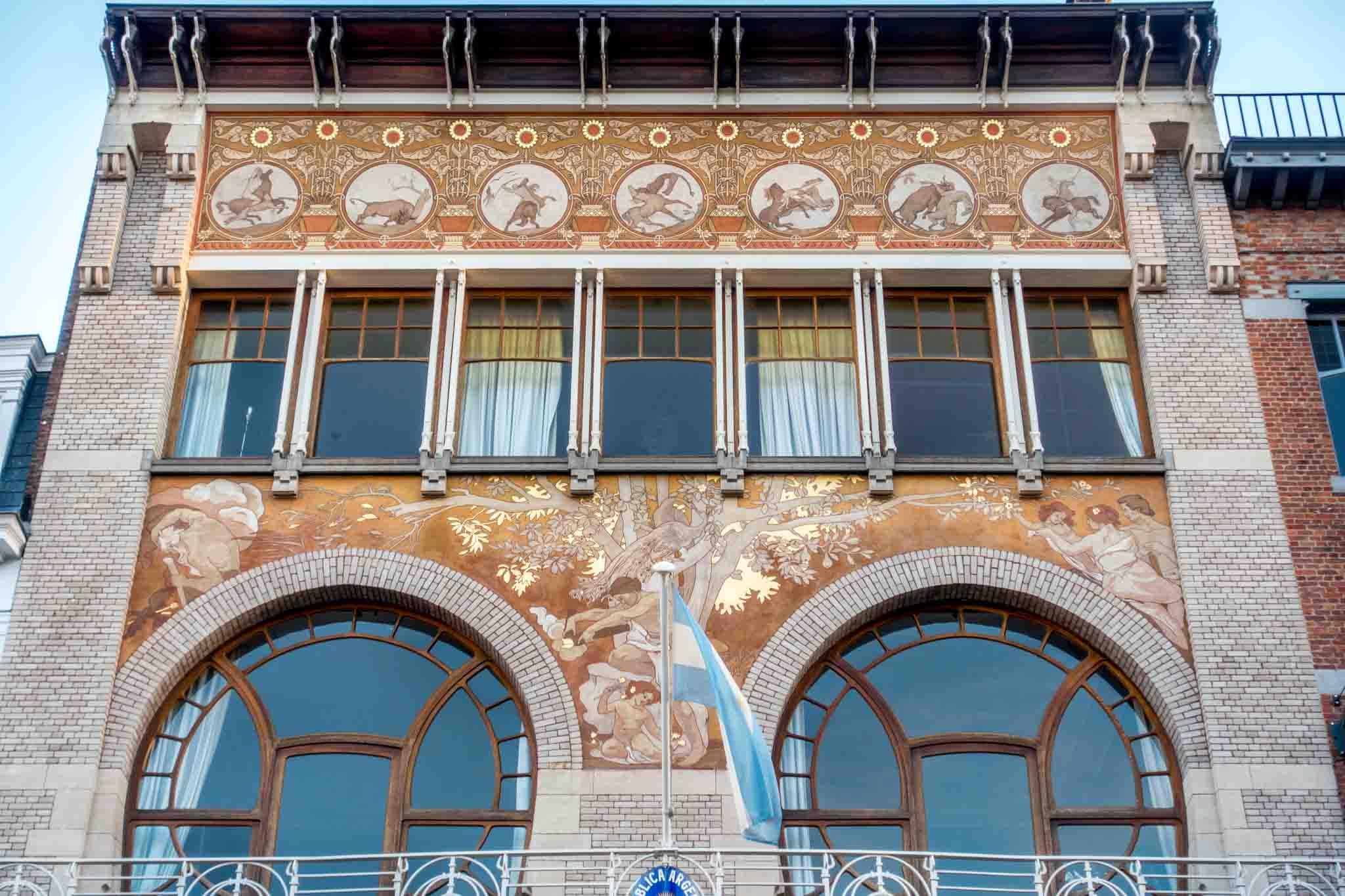 Art Nouveau building with circular windows and graphic tiled facade