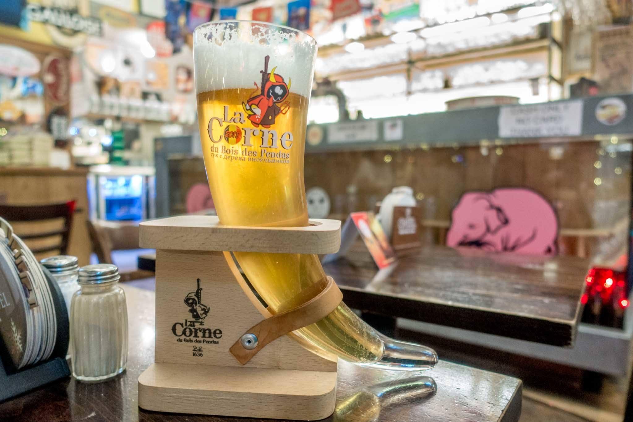 Horn-shaped glass full of beer