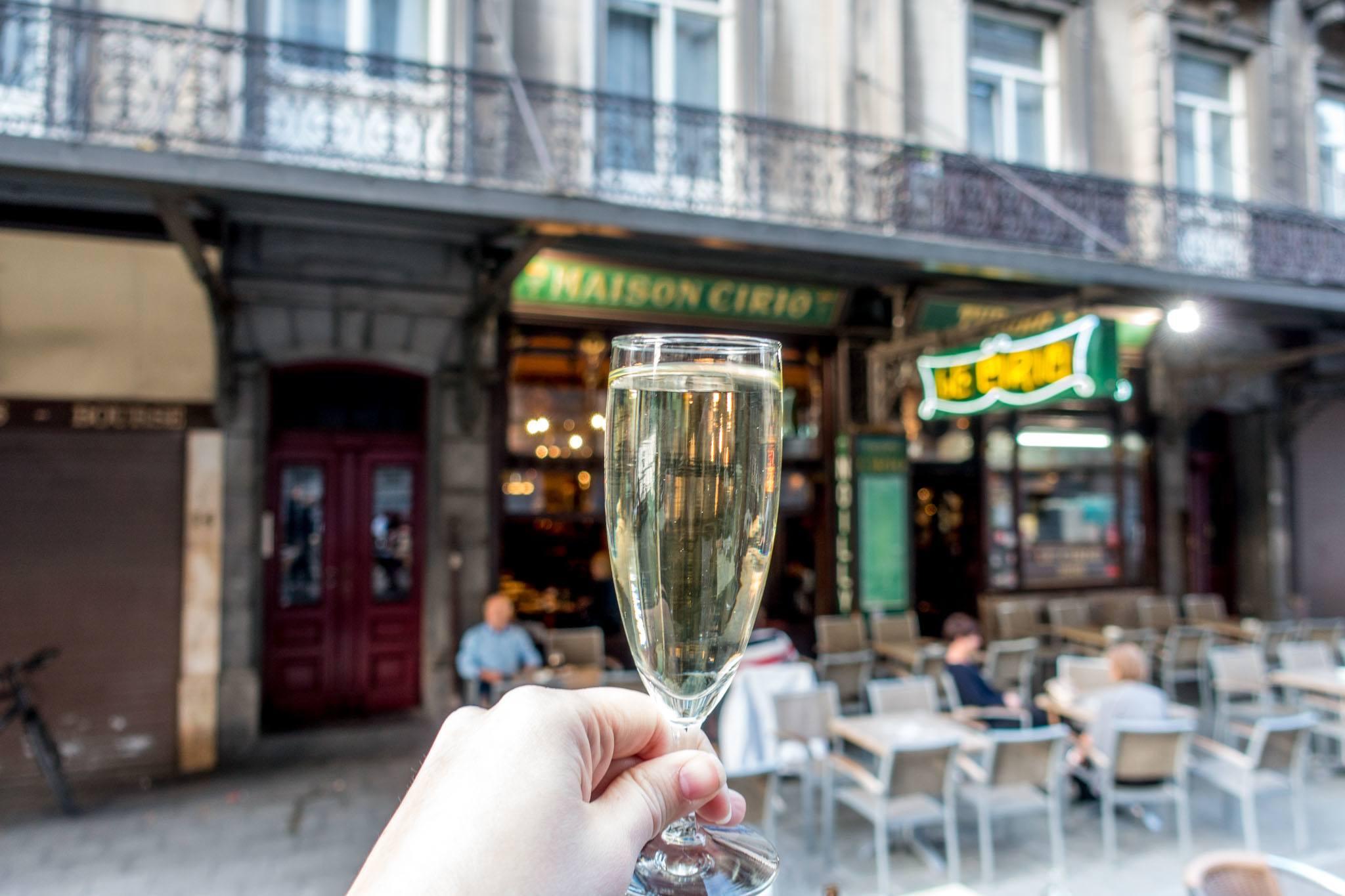 Glass of half-en-half cocktail at Le Cirio outdoor cafe