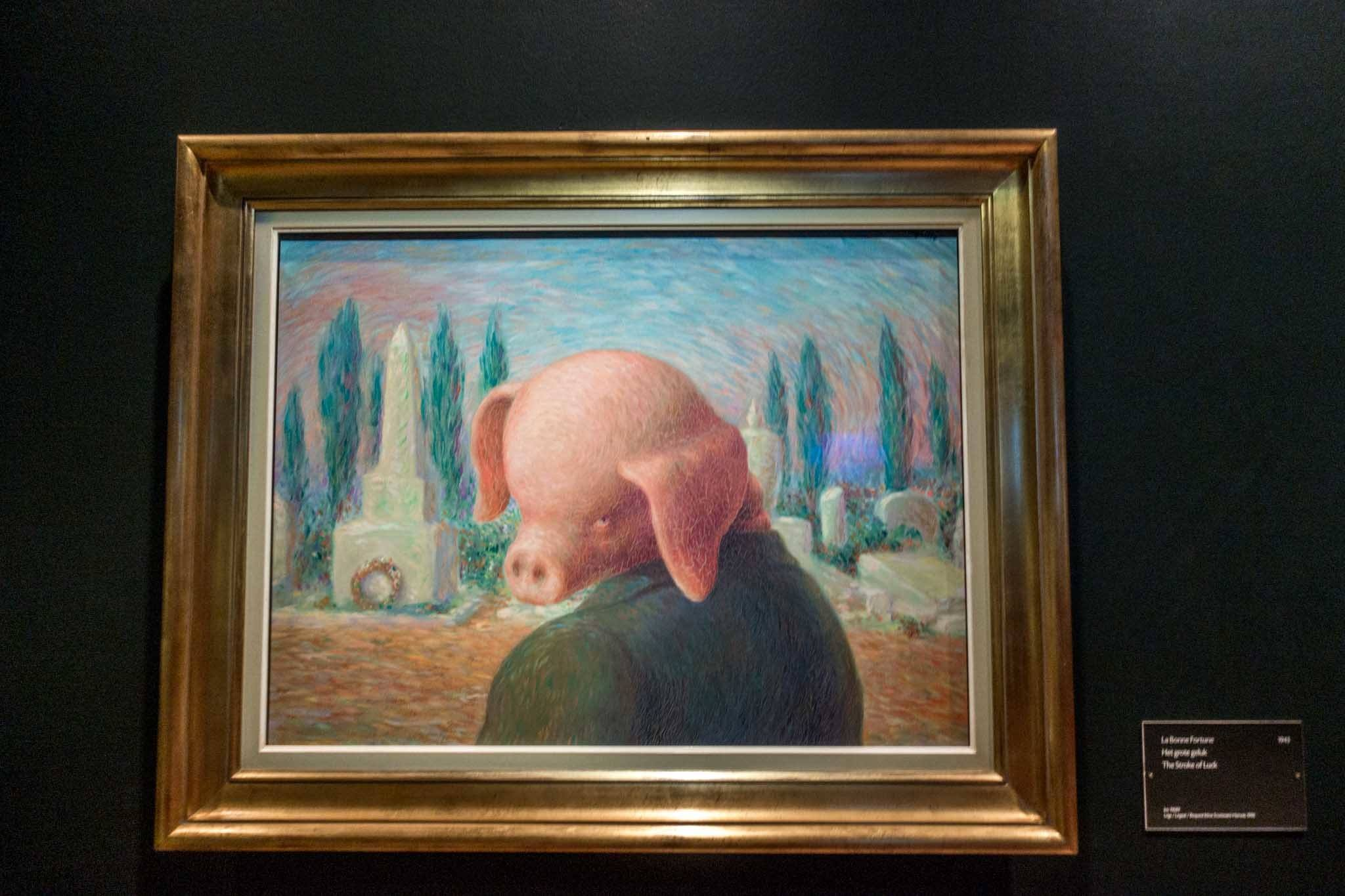 Painting by Magritte of figure with pig head and human body