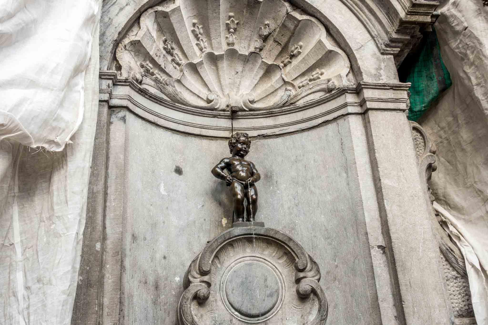 Manneken Pis, statue of a little boy peeing, in Brussels Belgium