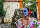 Woman with her face painted for the Day of the Dead festival at Xcaret in Playa del Carmen, Mexico