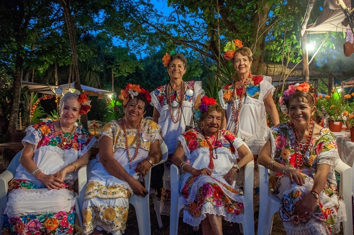 Women at Xcaret dressed for the Day of the Dead festival