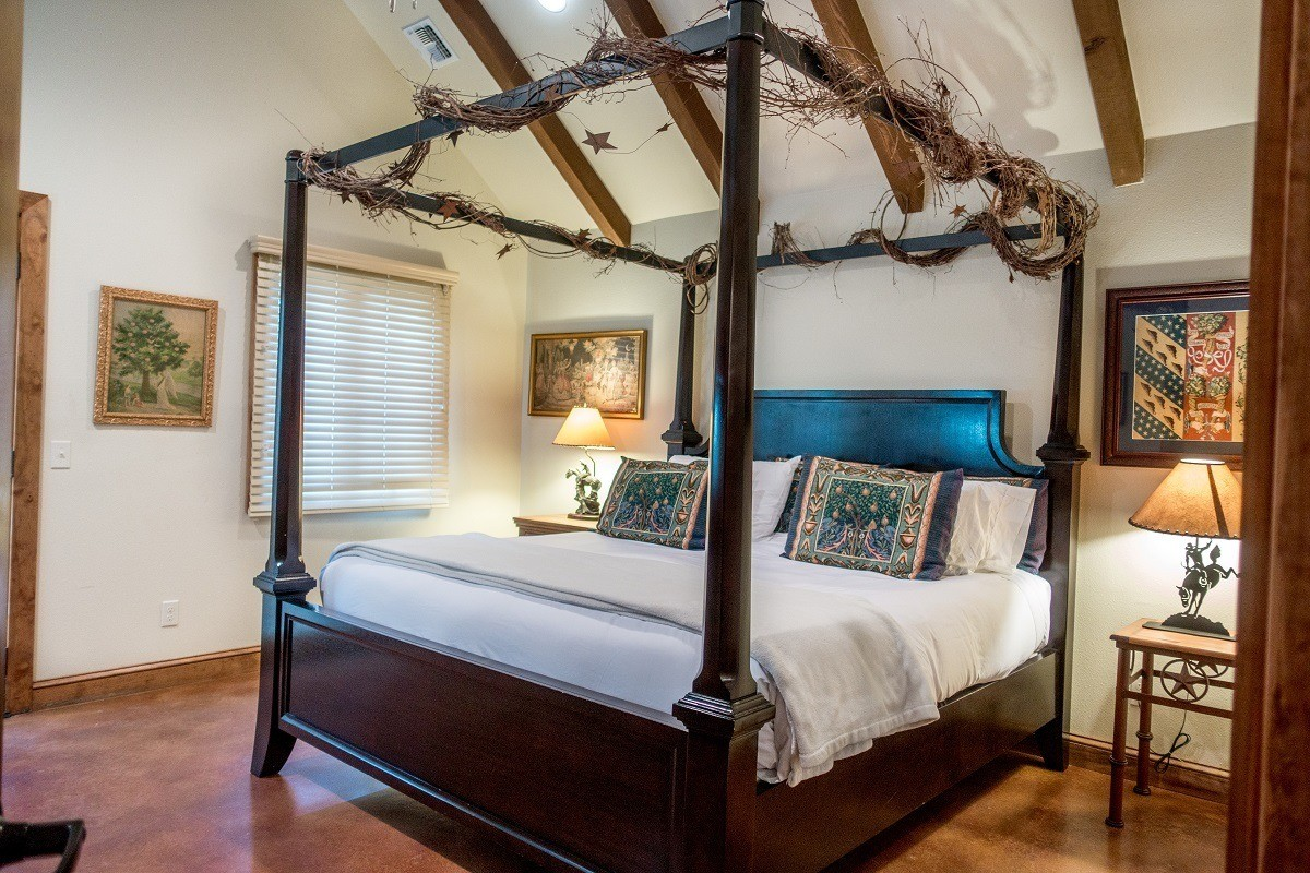 The comfortable, gorgeous bedroom at the Manor Haus B&B in Fredericksburg, Texas