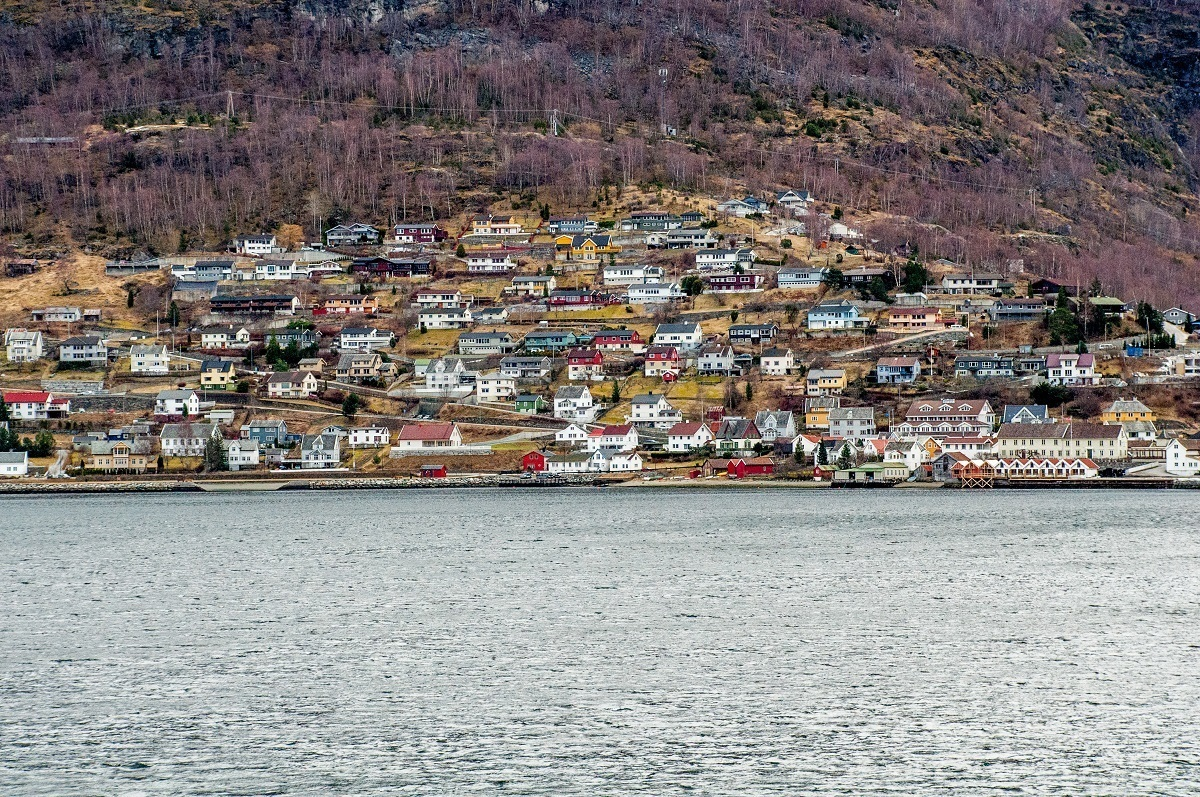 Buildings on a fjord hillside near the water