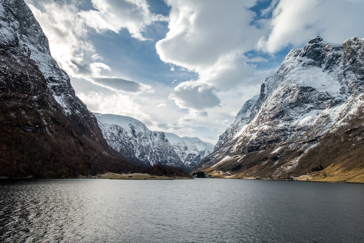 Water and snowy mountains of Naeroyfjord in Norway