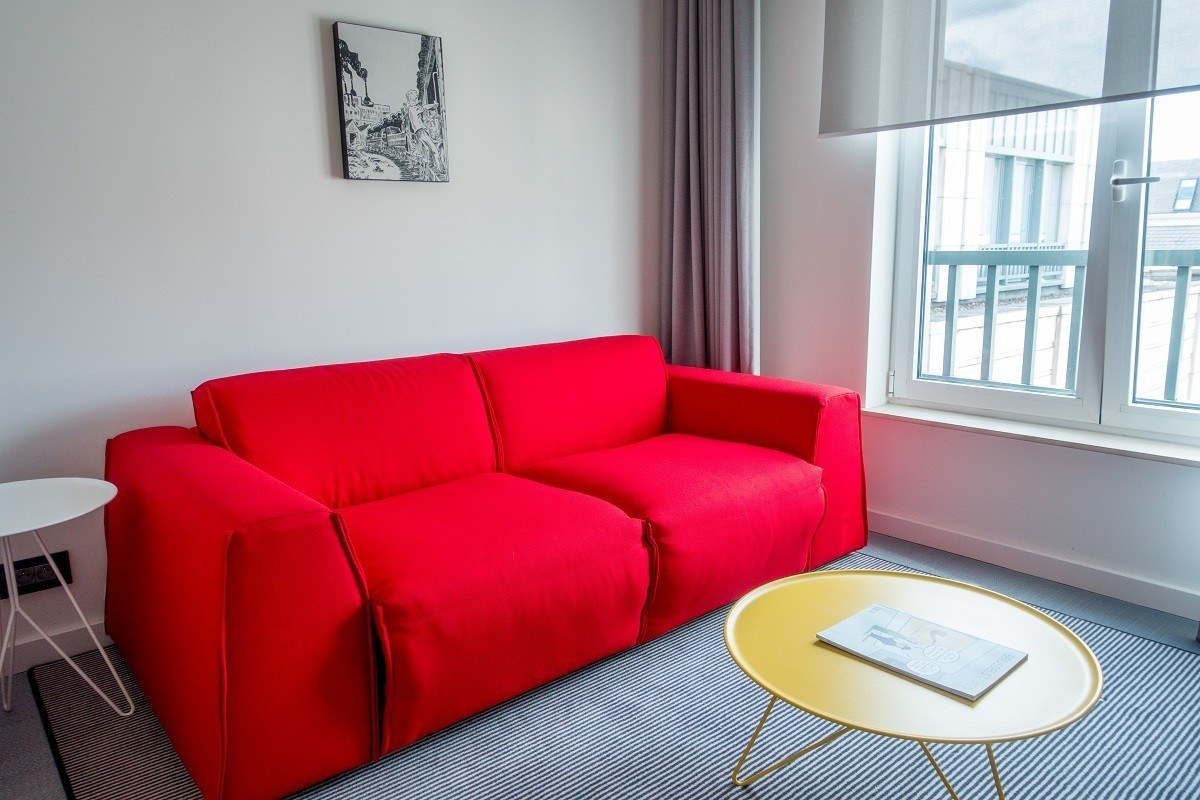 Red couch in hotel suite