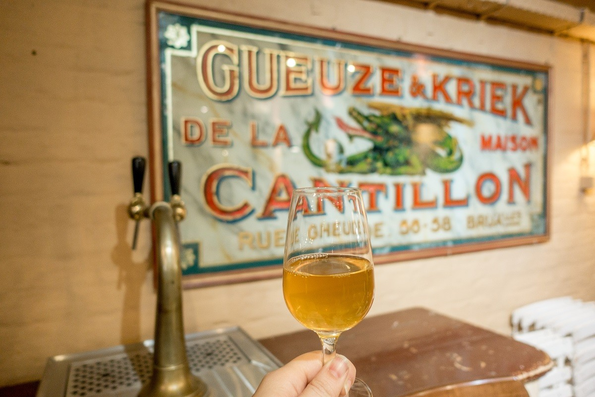 Glass of gueuze lambic at Cantillon Brewery