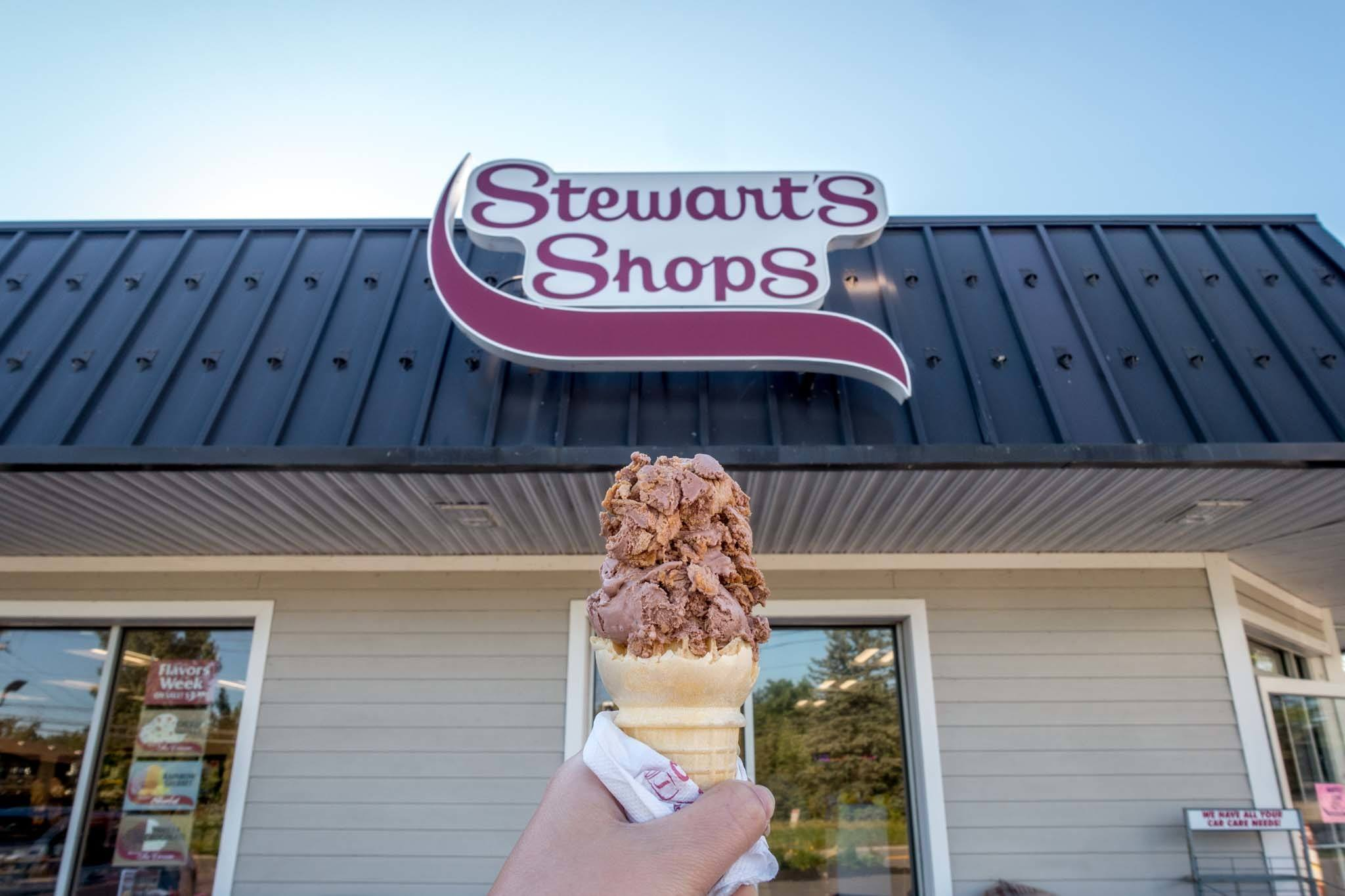 "Ice cream cone in front of ""Stewart's Shops"" sign"