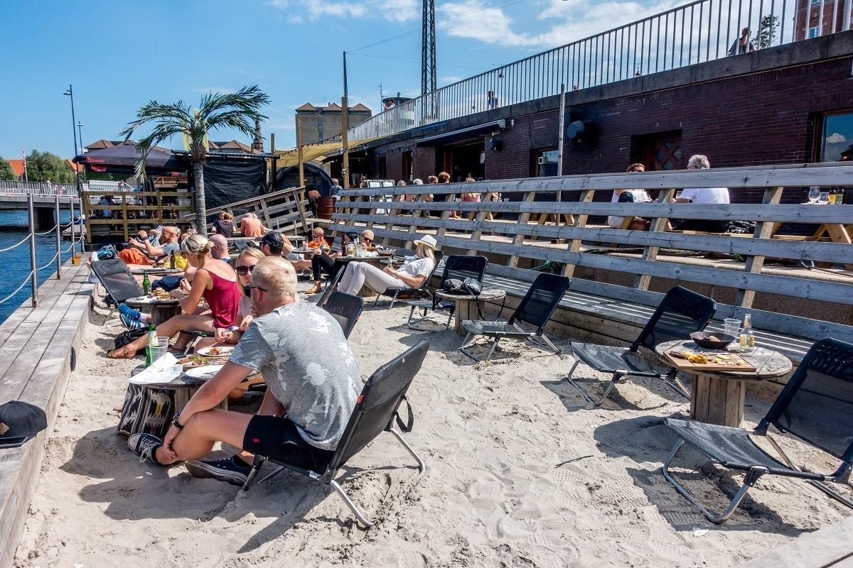 The beach at Kayak Bar in Copenhagen is unexpected and a fun place to hang out