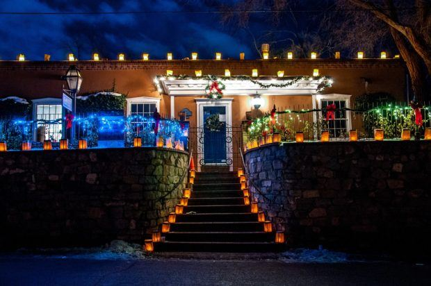 Private homes on Canyon Road are decorated with lanterns for the Santa Fe Farolito Walk on Christmas Eve.