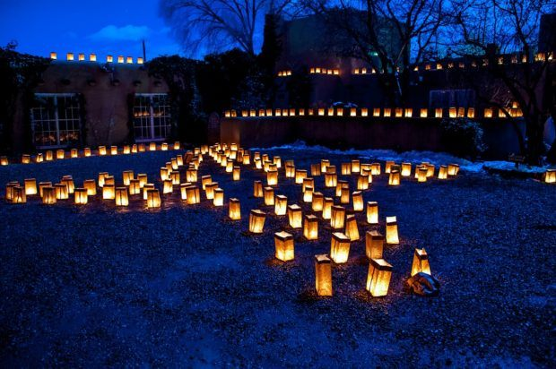 Illuminated lanterns is a hallmark of the farolito walk Santa Fe tradition.
