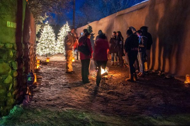 A Santa Fe Christmas tradition: carolers around the luminaries on Canyon Road.