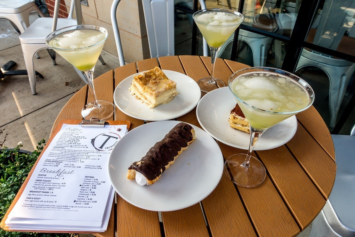 Cocktails and pastries on table