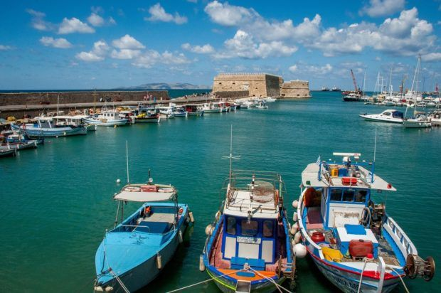 See the colorful boats in the habor of Heraklion when you explore Crete