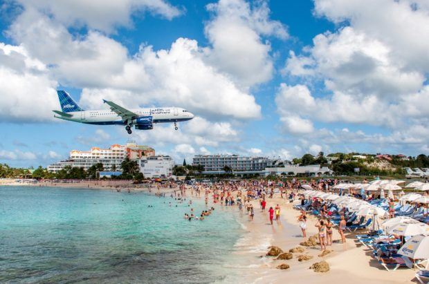 Planes flying low over Maho Beach in St. Maarten