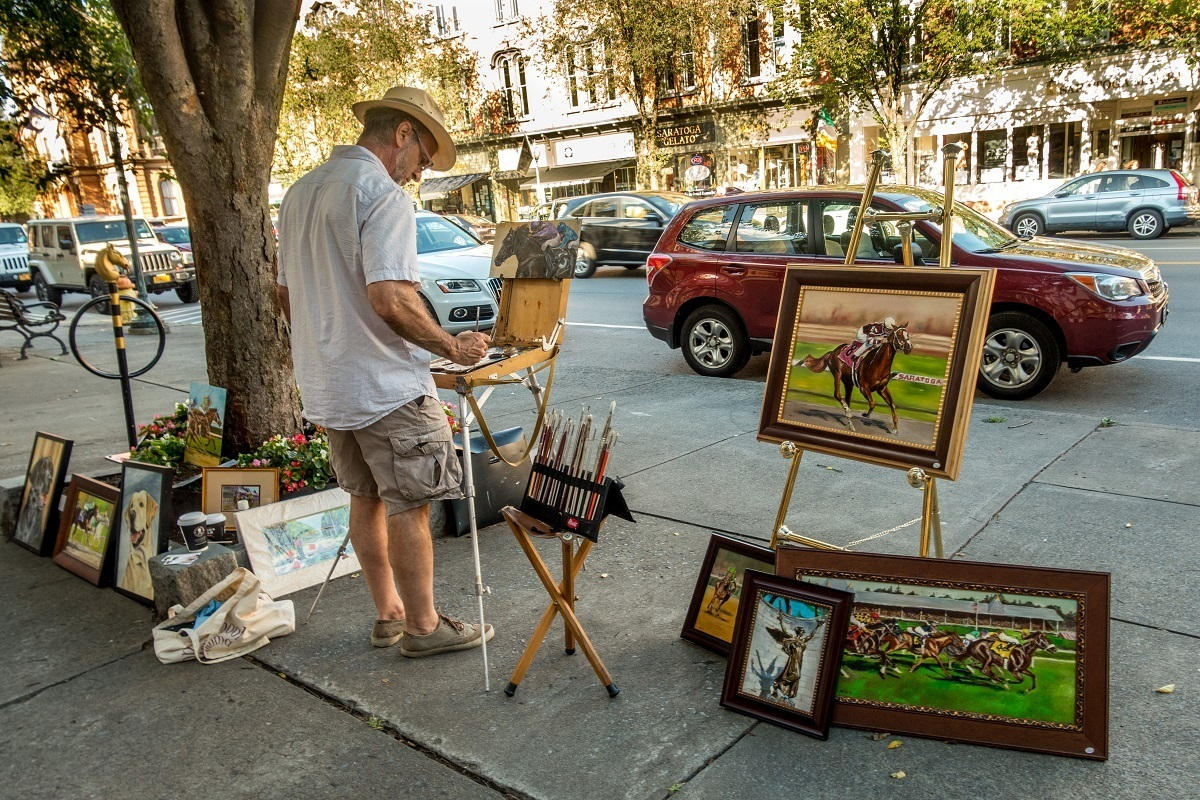 Man painting on street in Saratoga Springs, New York