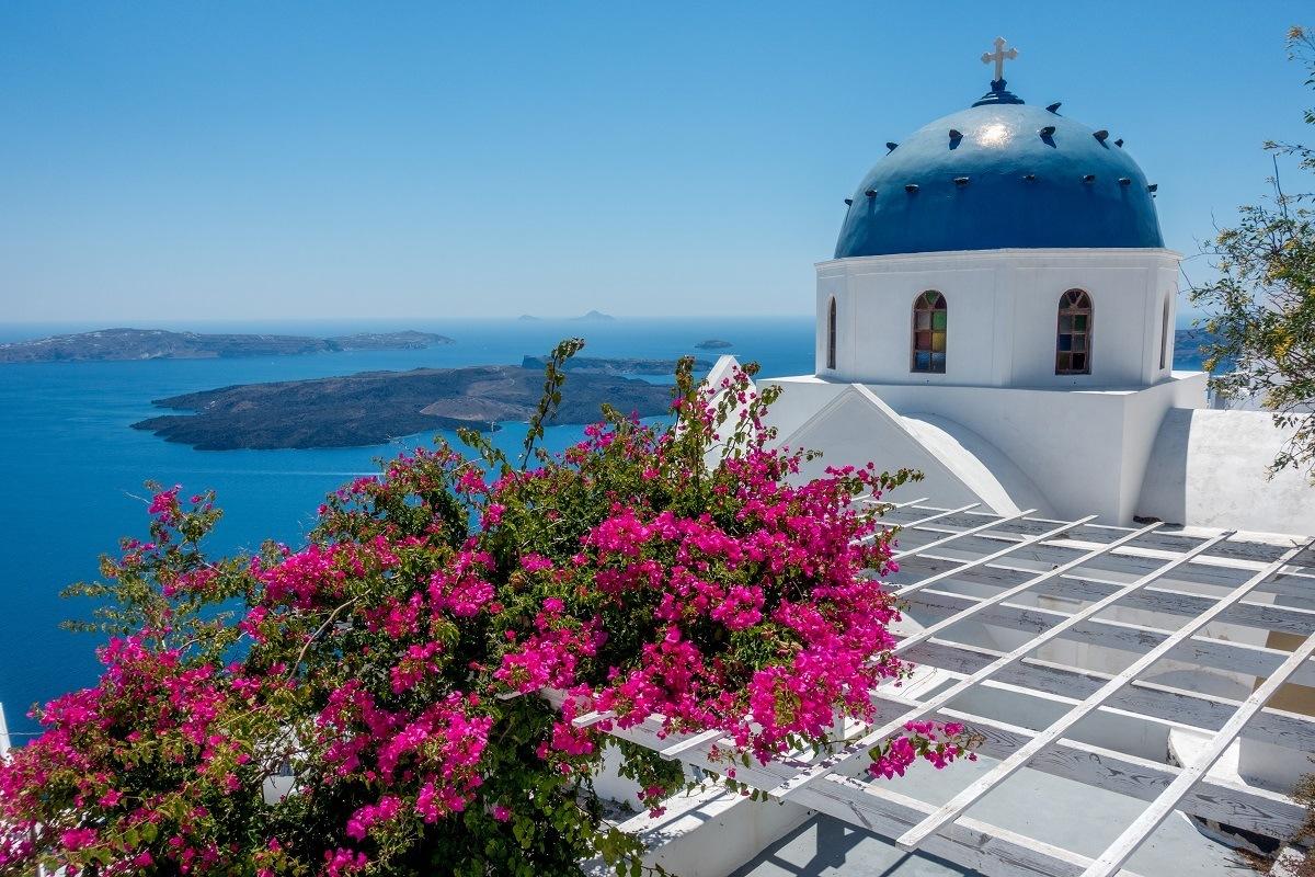 Blue-domed building overlooking the ocean in Santorini