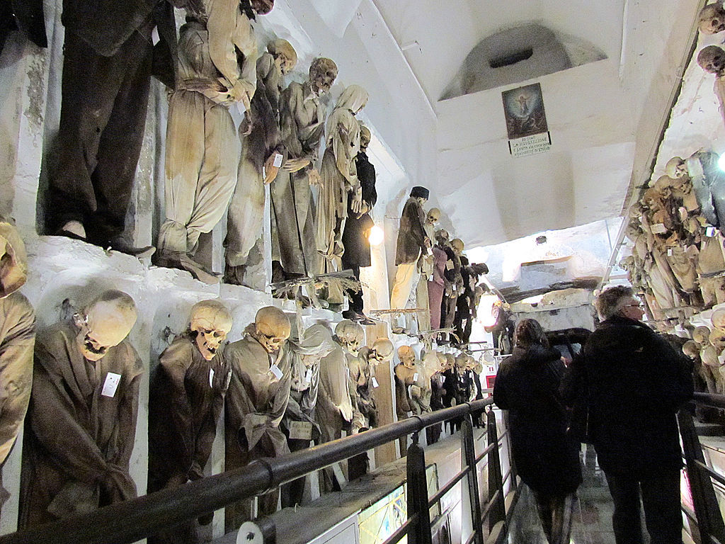 Skeletons and mummies line the walls of Palermo's Capuchin Catacombs