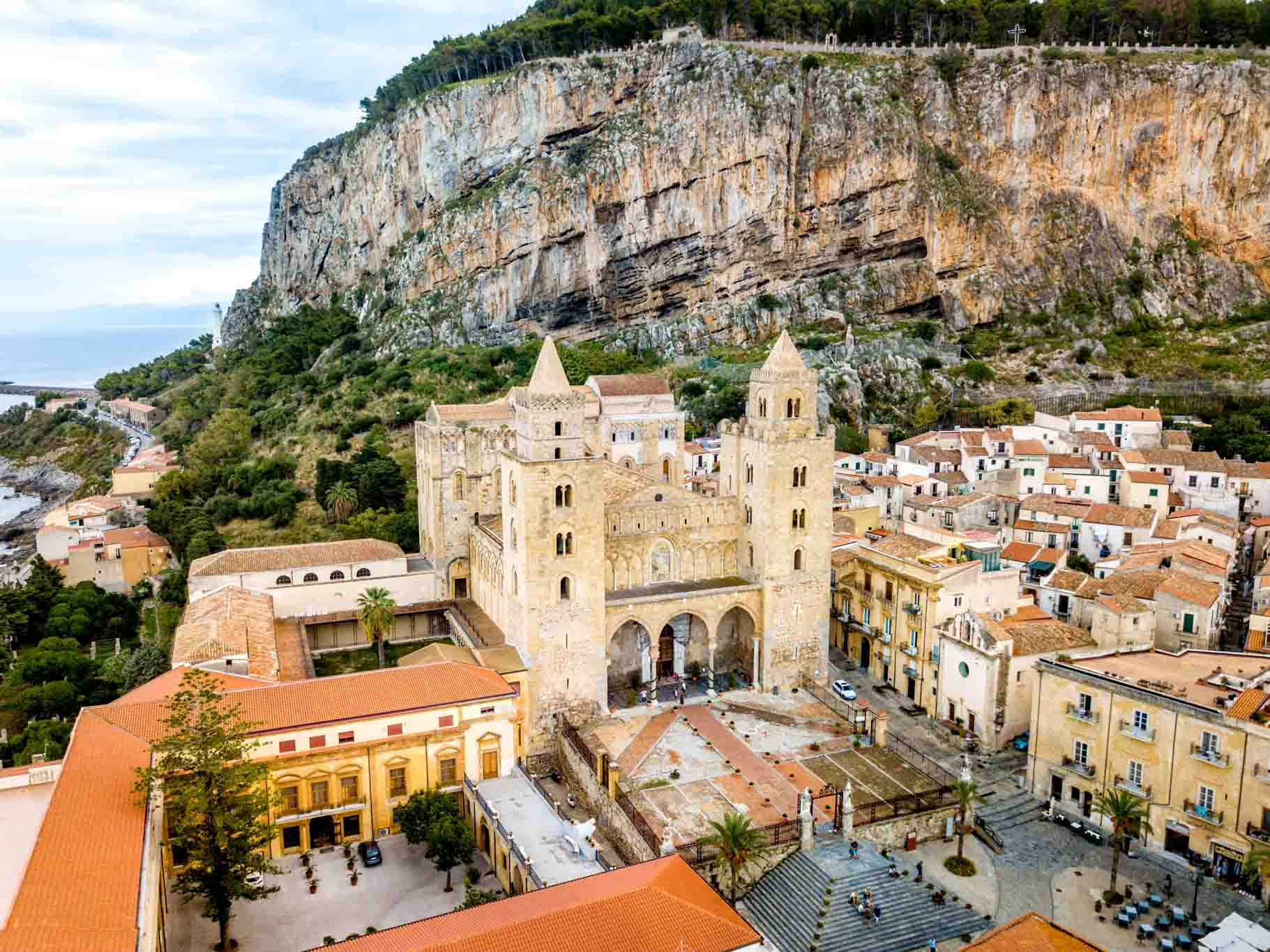 Overhead view of Cefalu cathedral and buildings in front of monolithic rock