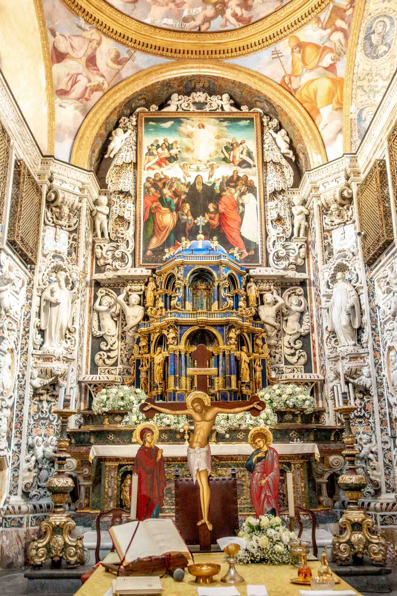 The elaborate carved marble altar at Martorana church with painting of Jesus
