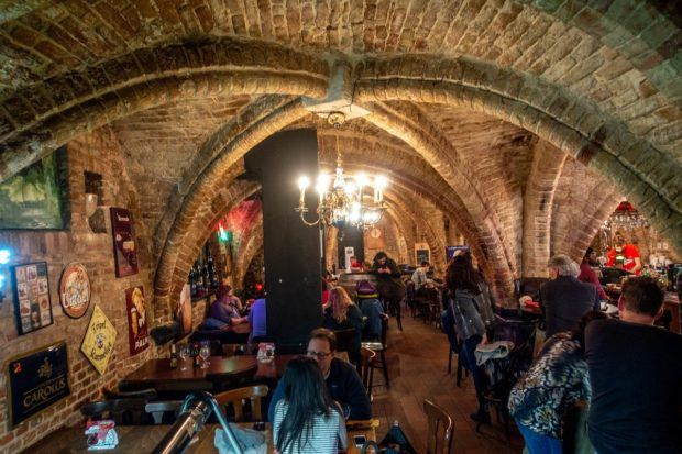 Visiting the underground Le Trappiste beer bar is what to do in Bruges Belgium near Market Square
