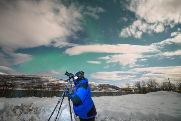 Photographing the northern lights in Tromso dressed in our heavy Norway winter clothing.