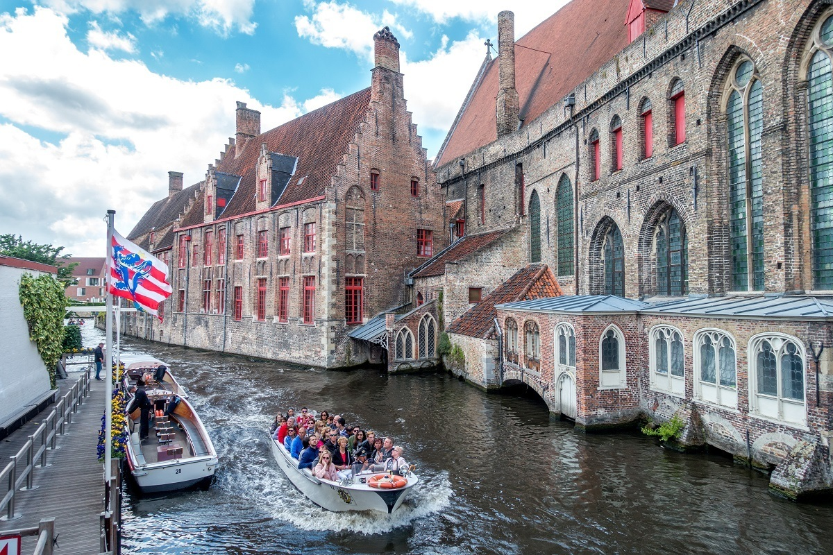 Boat cruising the canal in Bruges Belgium