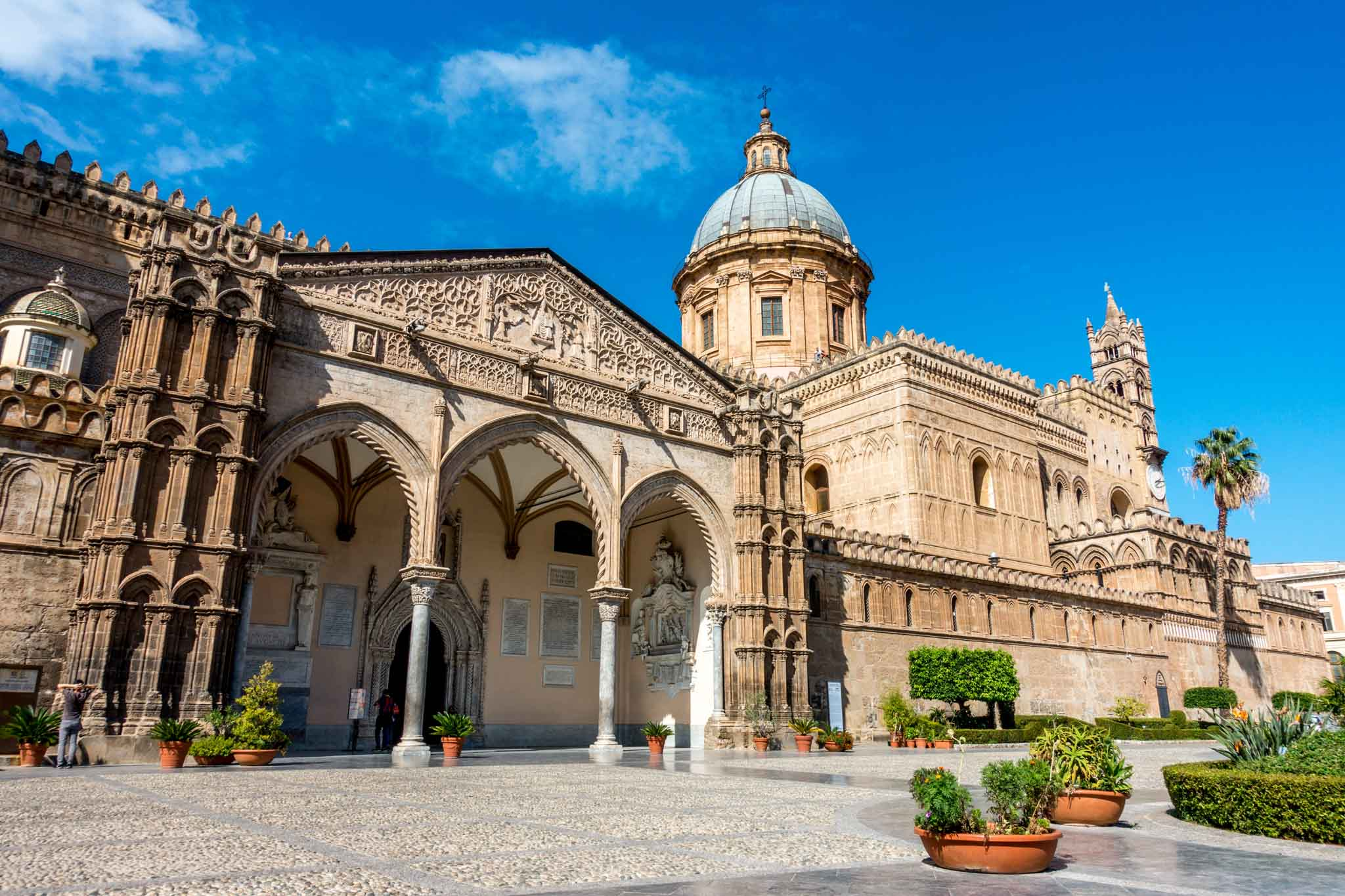 Exterior of Palermo Cathedral, a large stone building with domed roof