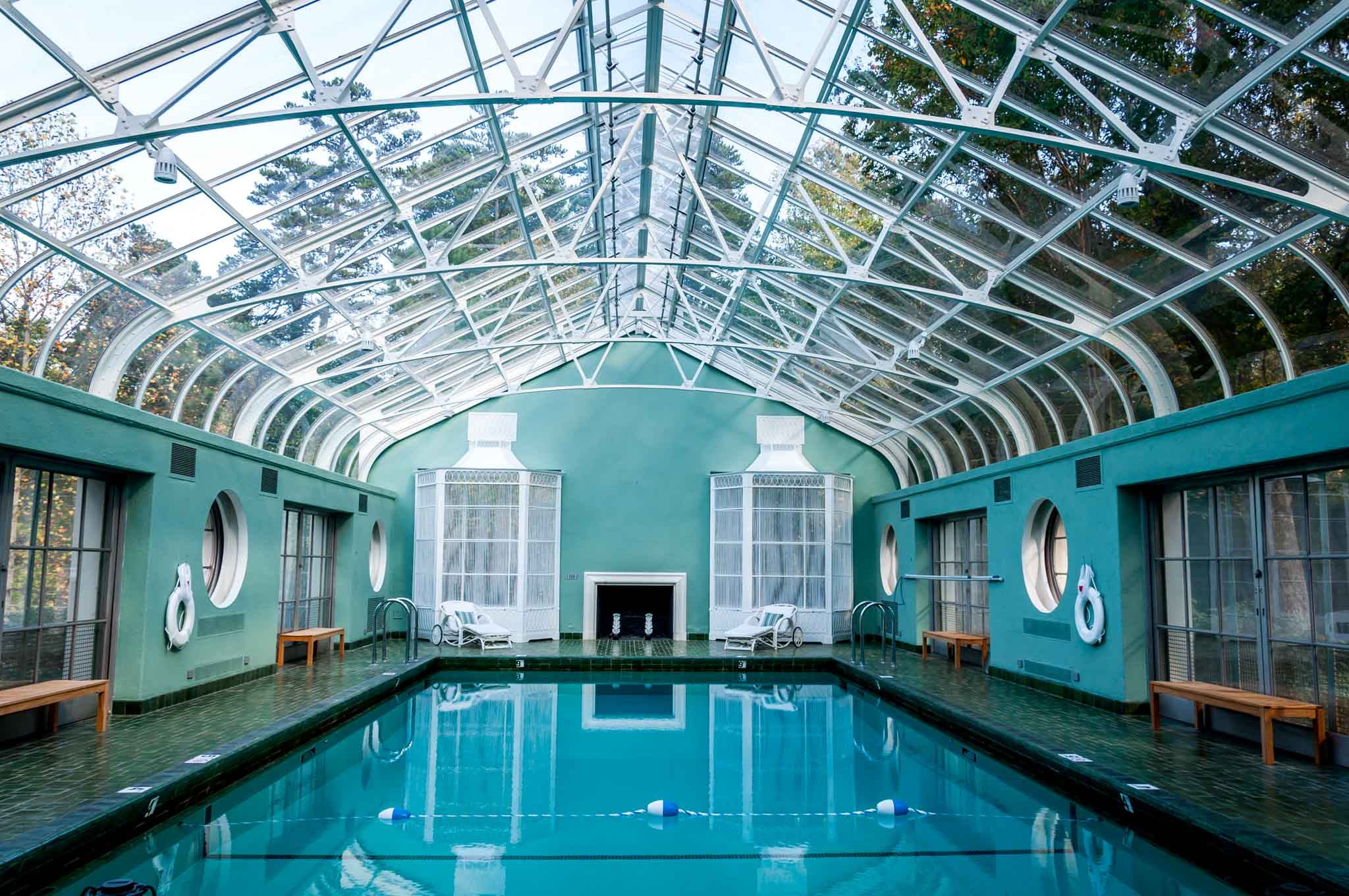 Indoor pool in room with a glass ceiling at the Reynolda House Museum