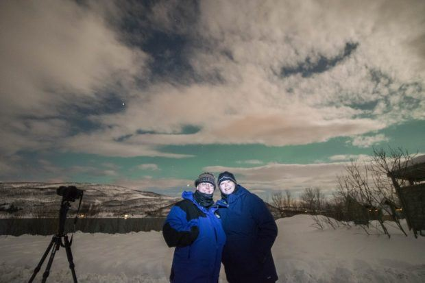 Use a short burst from a flashlight to take a northern lights selfie. It's cold so clothing in Norway can be heavy!  This isn't the place to make a fashion statement.