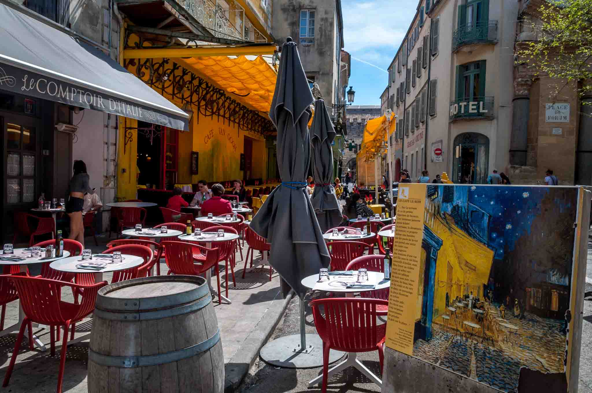 Modern-day sidewalk cafe alongside the painting van Gogh made of the site in the 1800s